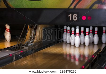 Close Up Of Alley At Bowling Club. Pin Bowling Alley Background. Closeup Of Ten Pin Row On A Lane, N
