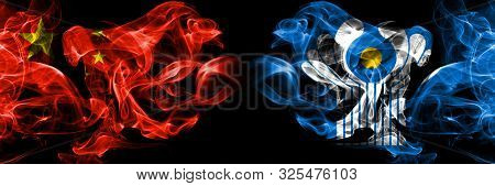 China Vs Commonwealth Smoke Flags Placed Side By Side. Thick Colored Silky Smoke Flags Of Chinese An