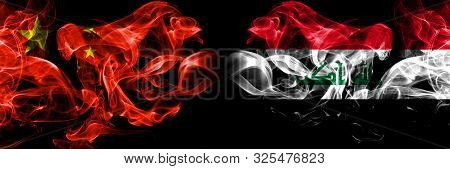 China Vs Iraq, Iraqi Smoke Flags Placed Side By Side. Thick Colored Silky Smoke Flags Of Chinese And