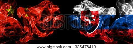 China Vs Slovakia, Slovakian Smoke Flags Placed Side By Side. Thick Colored Silky Smoke Flags Of Chi