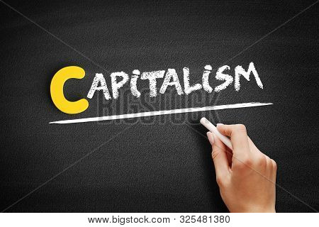 Capitalism Text On Blackboard, Business Concept Background
