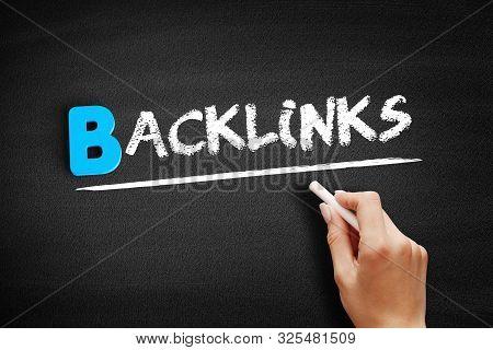 Backlinks Text On Blackboard, Business Concept Background