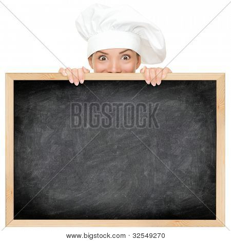 Chef showing restaurant menu blackboard - empty blank copy space for text. Funny woman cook peeking over sign. Beautiful happy mixed race Caucasian / Asian female model. Isolated on white background.