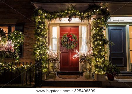 An Exterior House Door Decorated With Christmas Ornaments