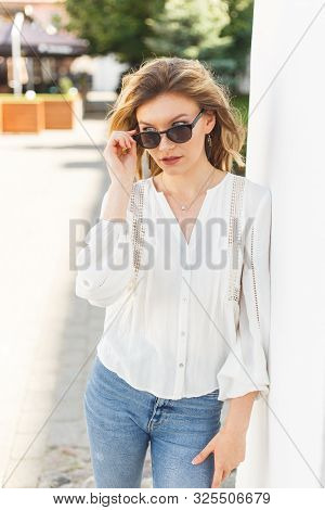 Beautiful Young Woman In White Blouse Smiling Standing Outdoor