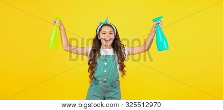 Miss Clean. Clean Home Is Happy Home. Happy Little Girl Hold Spray Bottles On Yellow Background. Sma