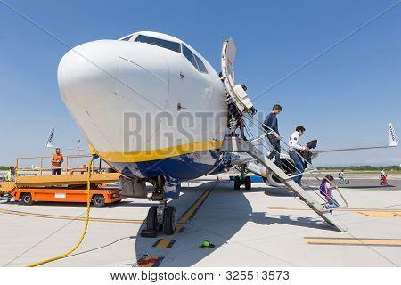 Trieste Airport, Italy - 20 April 2018: People Boarding Ryanair Plane On Friuli Venezia Giulia Airpo