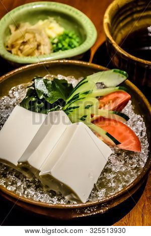 Tofu On Ice Appetiser With Kombu Kelp, Cucumber, Tomato And Soy Sauce On The Side