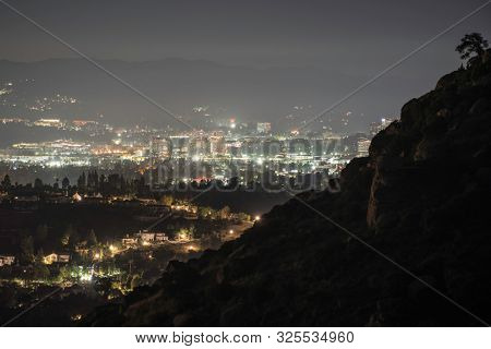 Night view towards Warner Center from the Santa Susana Mountains in the San Fernando Valley area of Los Angeles, California.