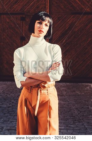 High Waisted Trousers Keep Returning To Catwalk. Fashion Girl. Femininity And Emphasize Feminine Fig