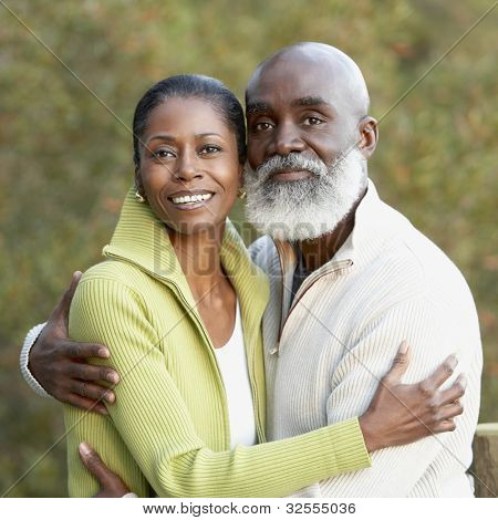Portrait of senior African couple hugging