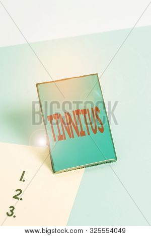 Writing note showing Tinnitus. Business photo showcasing A ringing or music and similar sensation of sound in ears. poster