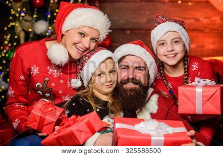 Christmas Joy. Happy Holidays. Parents And Children Opening Christmas Gifts. Cheerful Family Concept