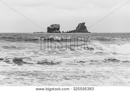 Two Rock Island Formations In The Middle Of The Ocean, In Front Of The Town Of Ayampe, Manabi, On An