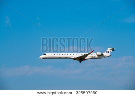Zurich, Switzerland - July 19, 2018: SAS airlines airplane flying in blue sky
