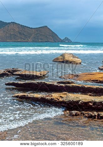 Rocks Of All Sizes With The Ocean And Sky In The Background, On An Overcast Day, At The Los Frailes