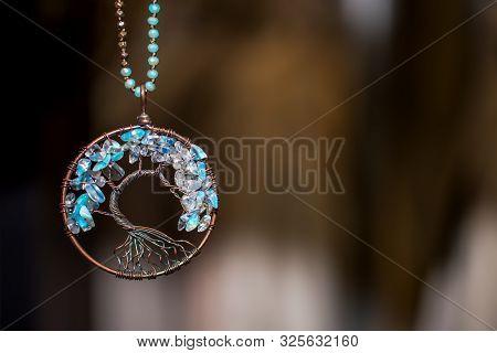 Copper Pendant Necklace With Aquamarine Stones. Tree Of Life On Dark Background