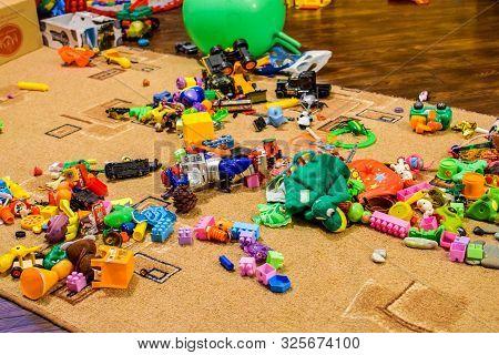Childrens Toys On The Carpet. Bardak In The Childrens Room.