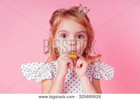 Little Blonde Girl With Curls Hairstyle In White Dress In Peas 4-5 Year Old In Studio On Pink Backgr