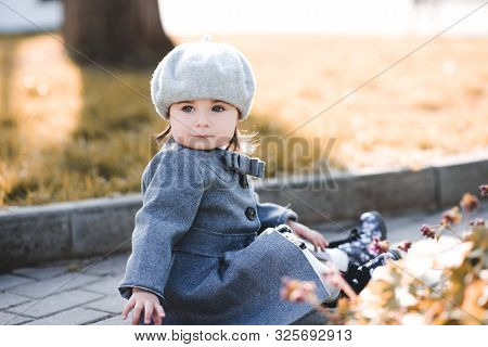 Cute Baby Girl 1-2 Year Old Wearing French Style Jacket And Beret In Park. Looking At Camera. Spring