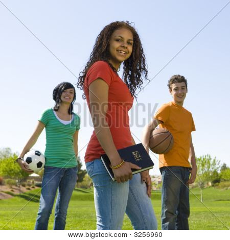 Three Teens With Bible