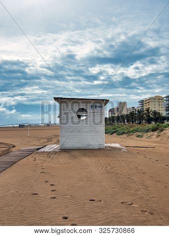Wooden Toilet House On The Beach Of Gandia, Valencia In A Rainy And Rainy Day