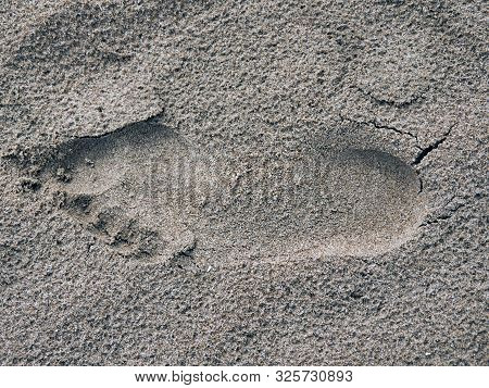 Human Footprint In The Wet Sand Of The Beach Of Gandia, Valencia,
