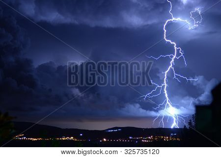 Dangerous Storm Of Lightning And Lightning In The Clouds That Touch The Ground