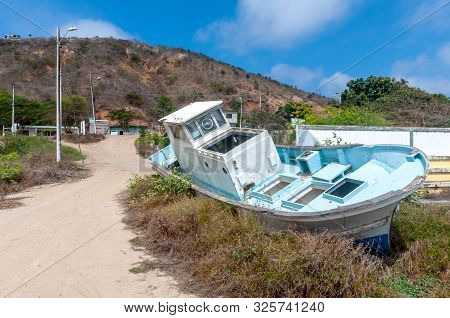 An Old And Abandoned Fishing Boat Off A Dirt Road In San Pedro, Manabi, Ecuador
