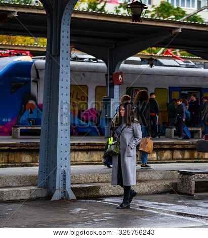 Young Girl Walking On The Platform Of Bucharest North Railway Station (gara De Nord Bucuresti) In Bu