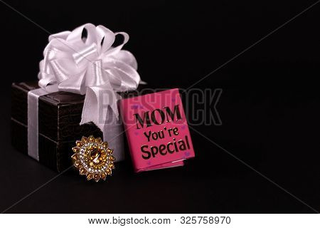 Mother's Day Gift Concept. Decorated Brown Leather Gift Box And Mom You're Special Mini Message Diar