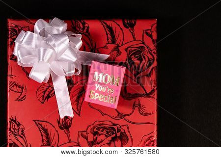Red Gift Box Decorated With White Ribbon And Mom You're Special Mini Message Book On Black Backgroun