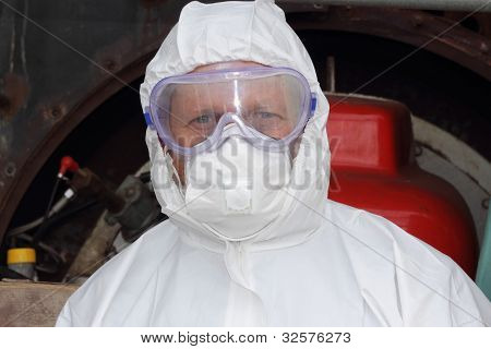 engineer ready to start cleaning an industrial steam boiler with correct ppe all in place poster