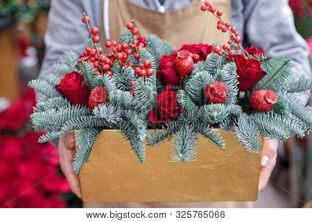 Winter Decor. Beautiful Flower Arrangement Of Red Roses, Natural Sprigs Of Blue Spruce And Christmas