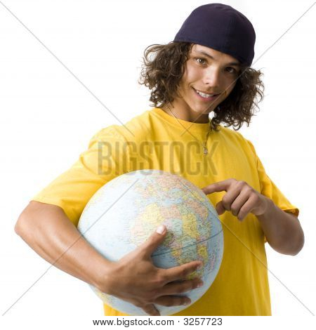 Boy Points To Globe