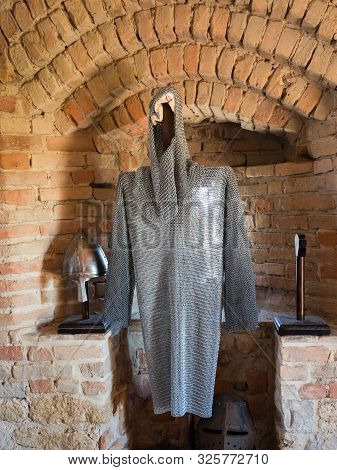 Chain Mail Of A Medieval Knight Against Stone Wall