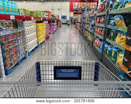 Orlando,fl/usa -10/4/19:  The Snack Aisle Of A Sams Club Wholesale Grocery Store With A Variety Of C