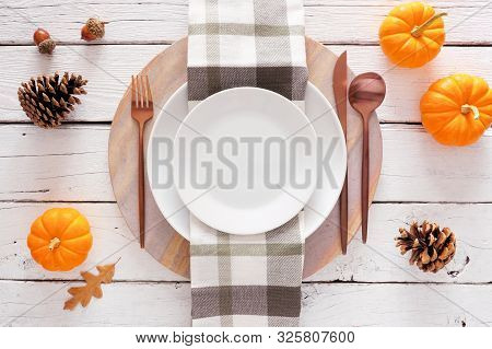 Fall Harvest Or Thanksgiving Dinner Table Setting With Plate, Flatware, Check Print Napkin, Pumpkins