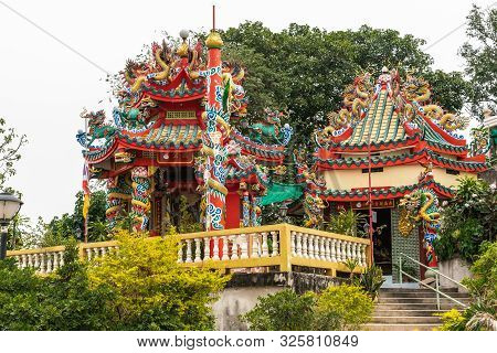 Si Racha, Thailand - March 16, 2019: Red, Gold, Yellow Wat Koh Loy Buddhist Shrines On The Hill Of K
