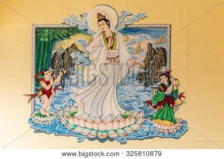 Si Racha, Thailand - March 16, 2019: Closeup Of Painting Of Guan Yin Set Against Yellow Wallin Her O