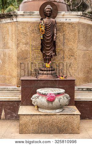 Si Racha, Thailand - March 16, 2019: Closeup Of Small Bronze Statue Of Enlightened, Compassionate Bo