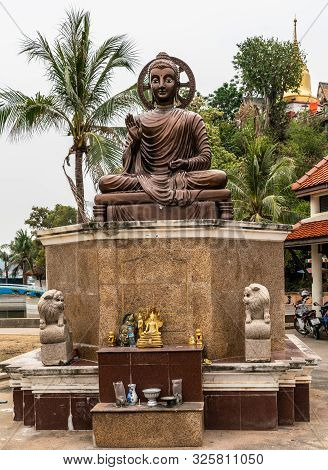 Si Racha, Thailand - March 16, 2019: Large Bronze Statue Of Sitting Enlightened, Compassionate Bodhi