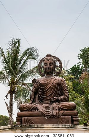Si Racha, Thailand - March 16, 2019: Closeup Of Bronze Statue Of Sitting Enlightened, Compassionate