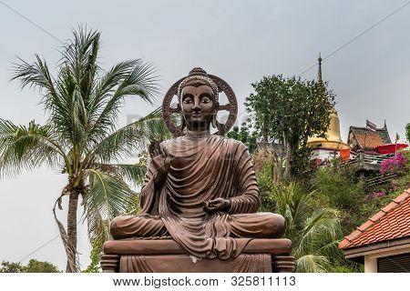Si Racha, Thailand - March 16, 2019: Bronze Statue Of Sitting Enlightened, Compassionate Bodhisattva