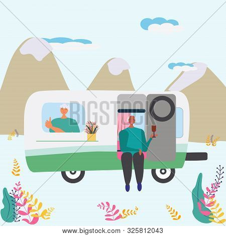 Old Couple Enjoying Time Together In Camper With Mountain Background. Van Life As Symbol Of Free Tra