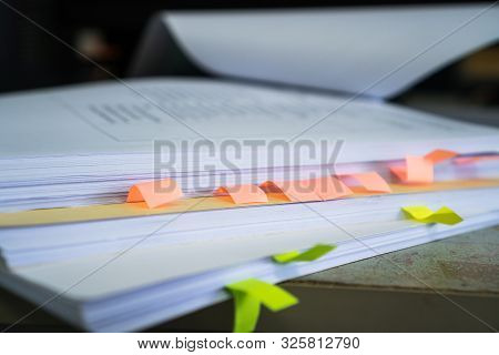 Stack Of Overwork Of Document Report With Post-it In Business Busy Concept: Piles Of Paper Files Wit