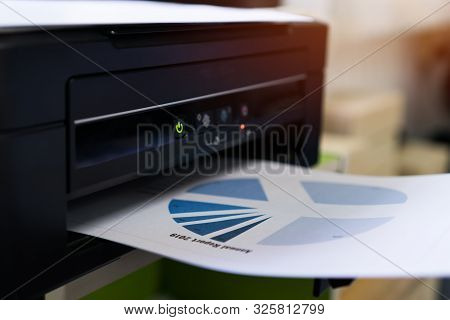 Printer Printing Document Graph Diagrams For Report Finacial Business In Office. Printer Scanner For