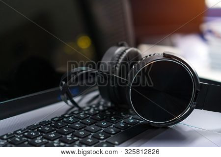Headset Or Headphone On Laptop Keyboard For Helpline Customer On Communication And Hotline Support C