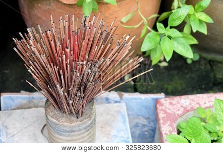 Burned Joss Sticks in Incense Burner. People Use to Worship, Pay Respect and Make Merit with The Buddha. poster