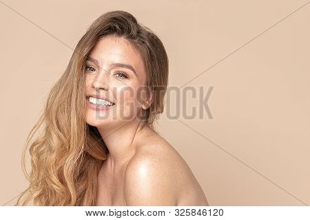 Natural Woman With Toothy Smile And Freckles.